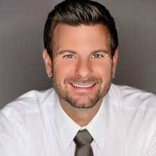 Tyson Zahner reviews his own story of being adopted. This image is of Tyson Zahner smiling in a headshot.